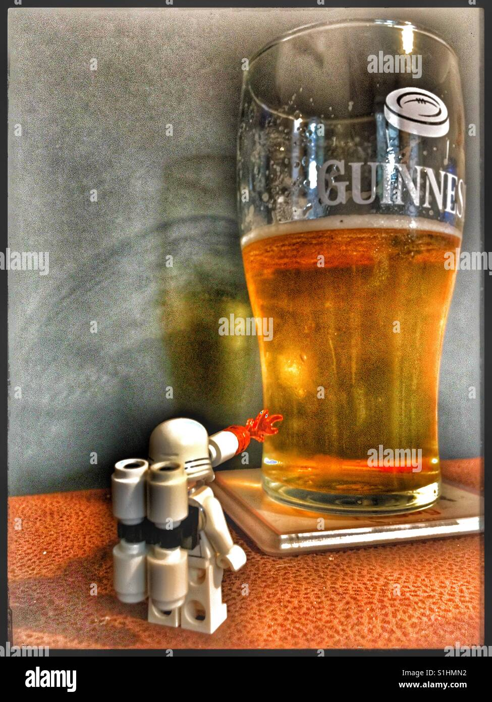 Lego Star Wars First Order Flametrooper mini figure with pint of Lager. - Stock Image