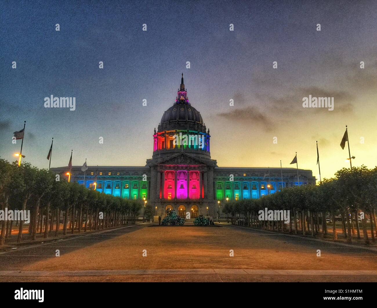 San Francisco City Hall lights up to celebrate the LGBT pride month - Stock Image