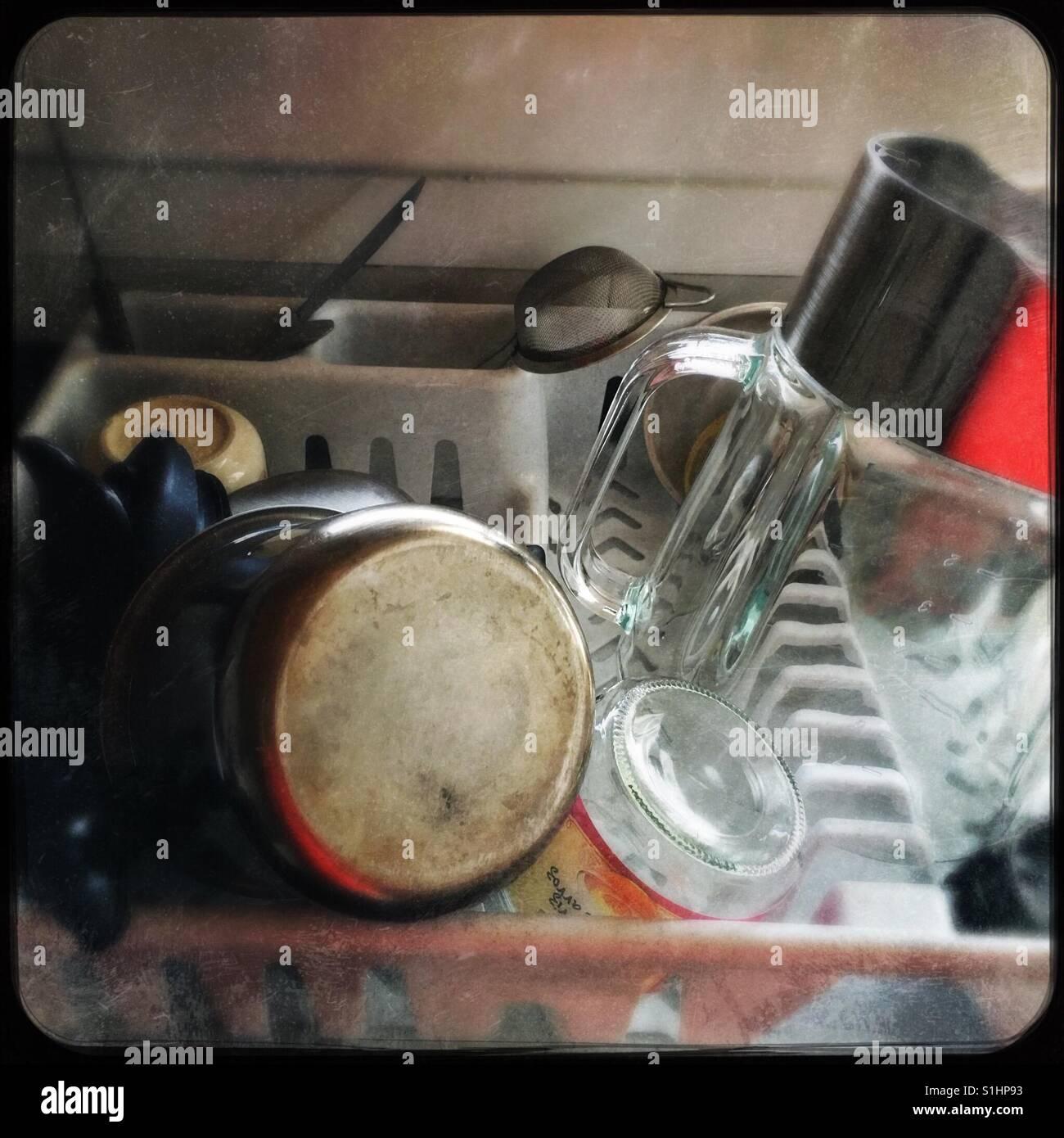 Kitchen utensils inside a wringer - Stock Image
