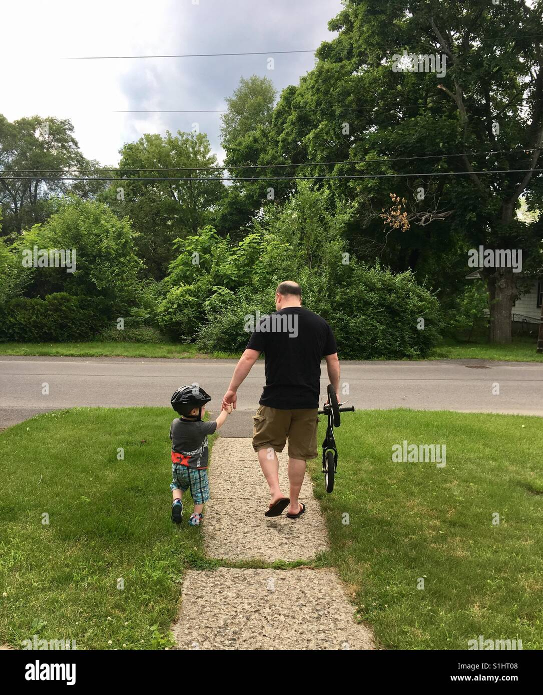 Father and son going for a bike ride - Stock Image