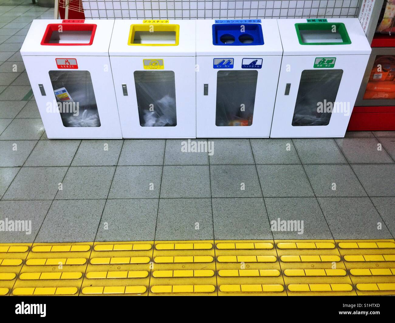 Color Coded Recycling Bins On Kyoto Train Station