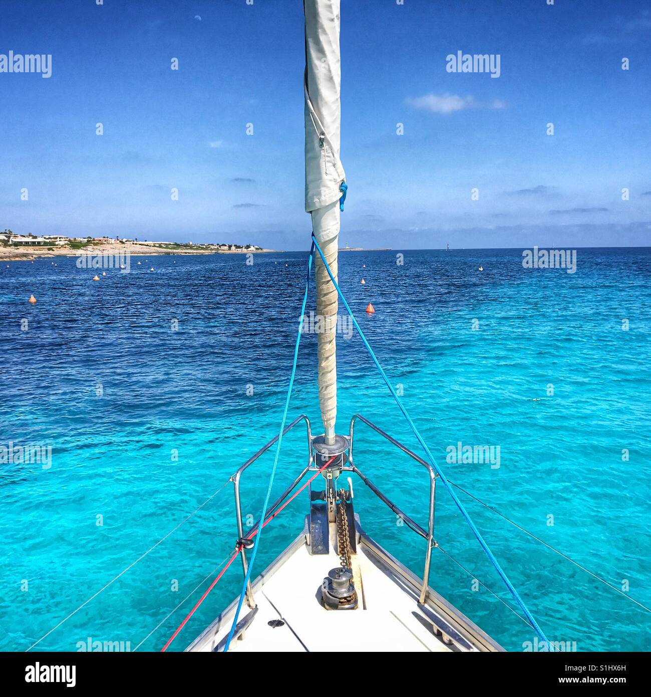 Sailing yacht anchored in azure blue water - Stock Image