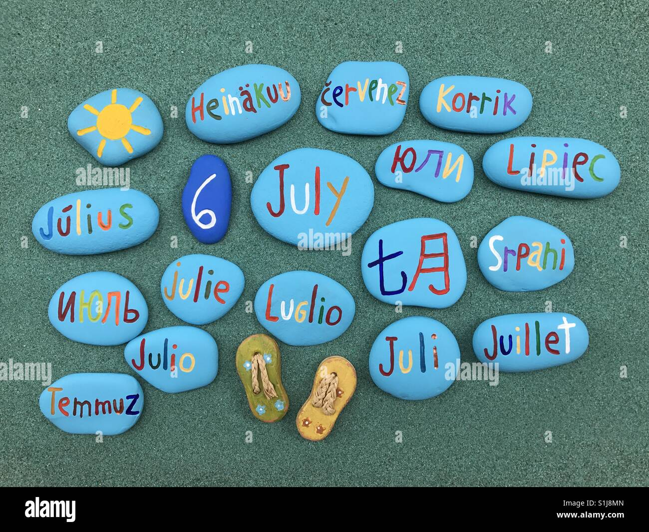6 July, calendar date in many languages and stones - Stock Image
