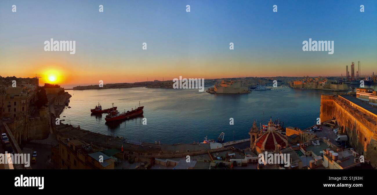 Sunrise over Valletta harbour in Malta. - Stock Image