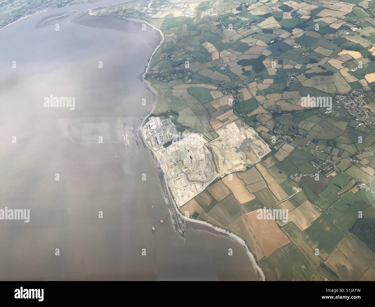 Hinkley point power station from the air showing how big it actually is. - Stock Image
