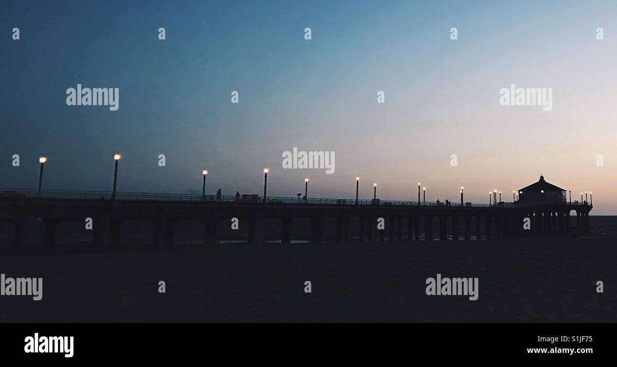 Summer night, Manhattan Beach pier at dusk with lights on. - Stock Image