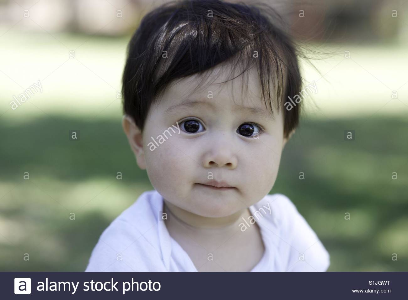 Wide eyed boy - Stock Image