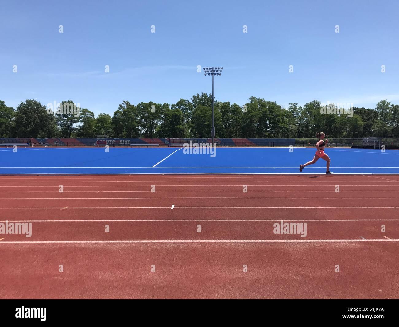 Running on UMass Lowell track - Stock Image