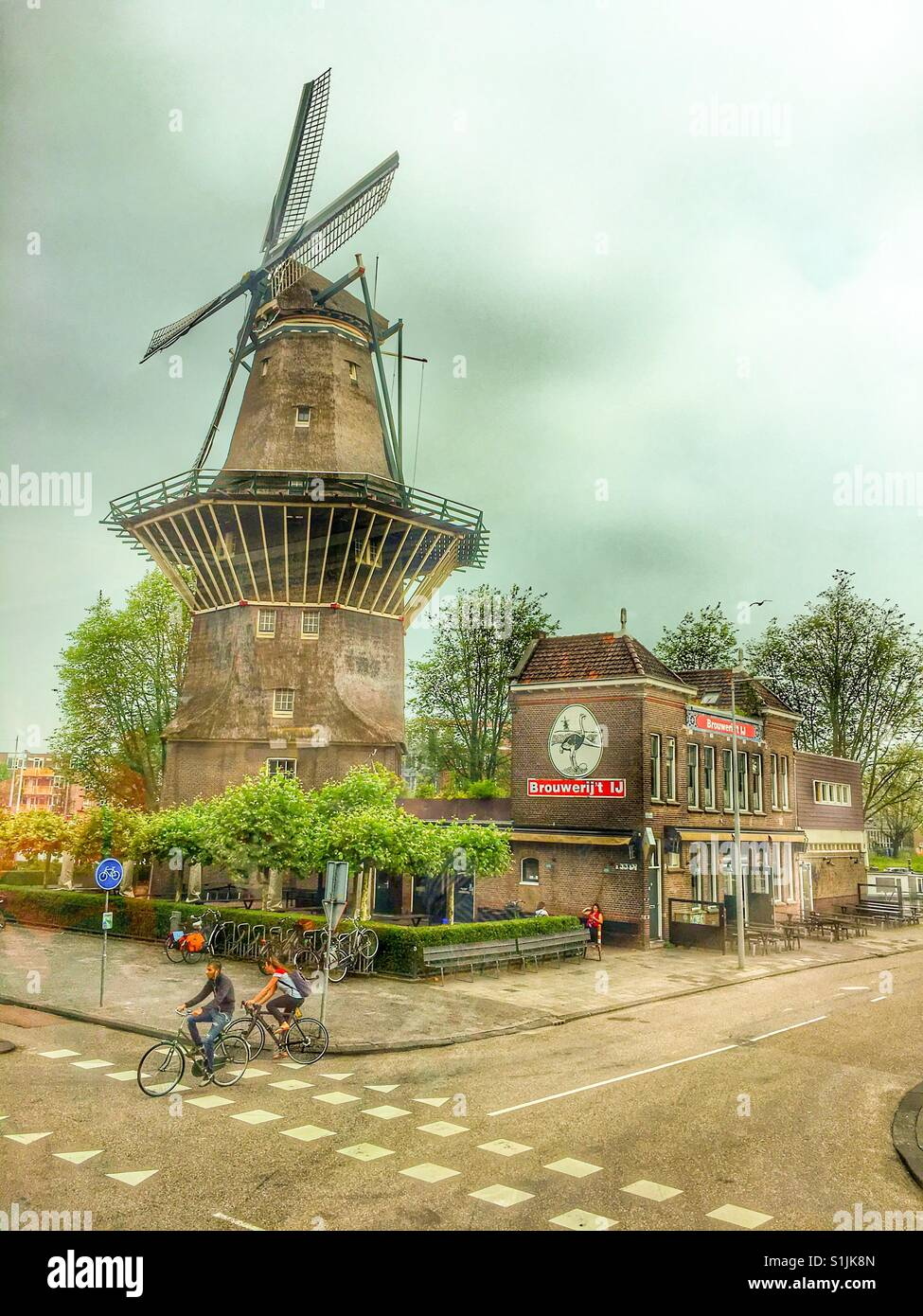 IJ Brewery and Gooyer Windmill in Amsterdam, Netherlands - Stock Image