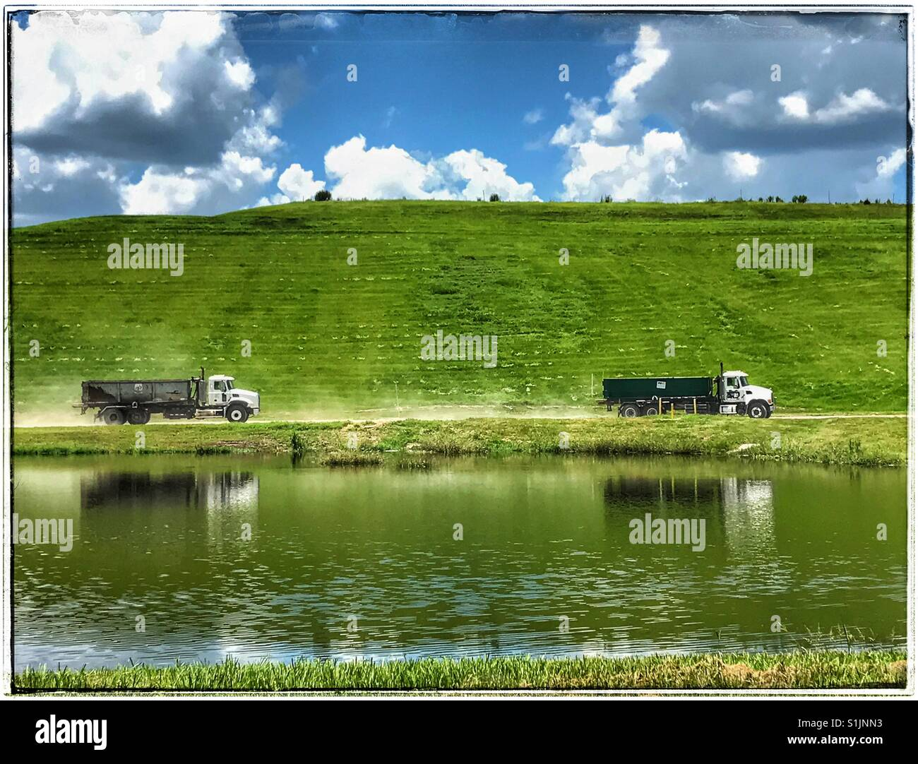 Idyllic sunny day at the land fill - Stock Image