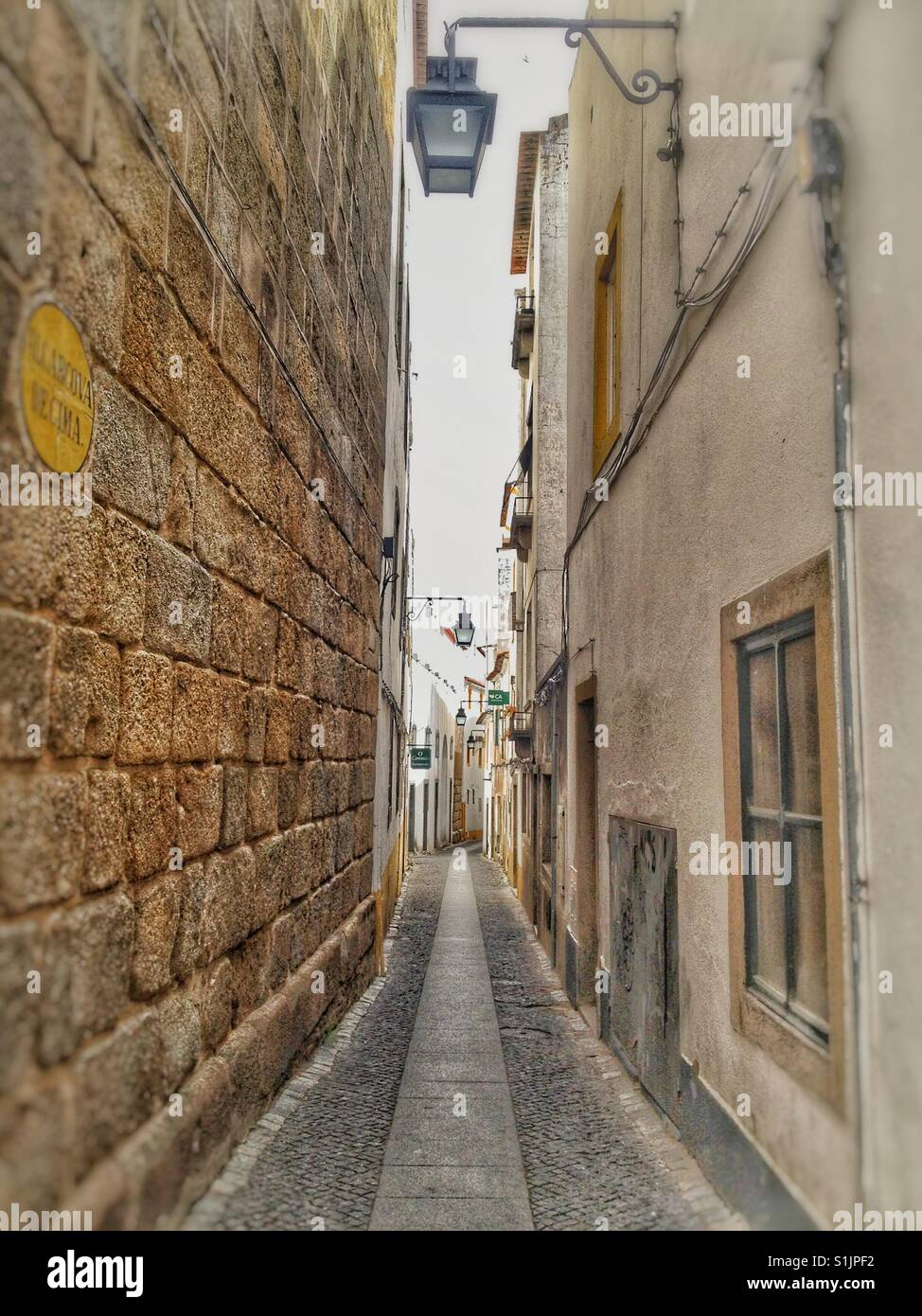 Typical narrow  street in Lisbon, Portugal. Stock Photo