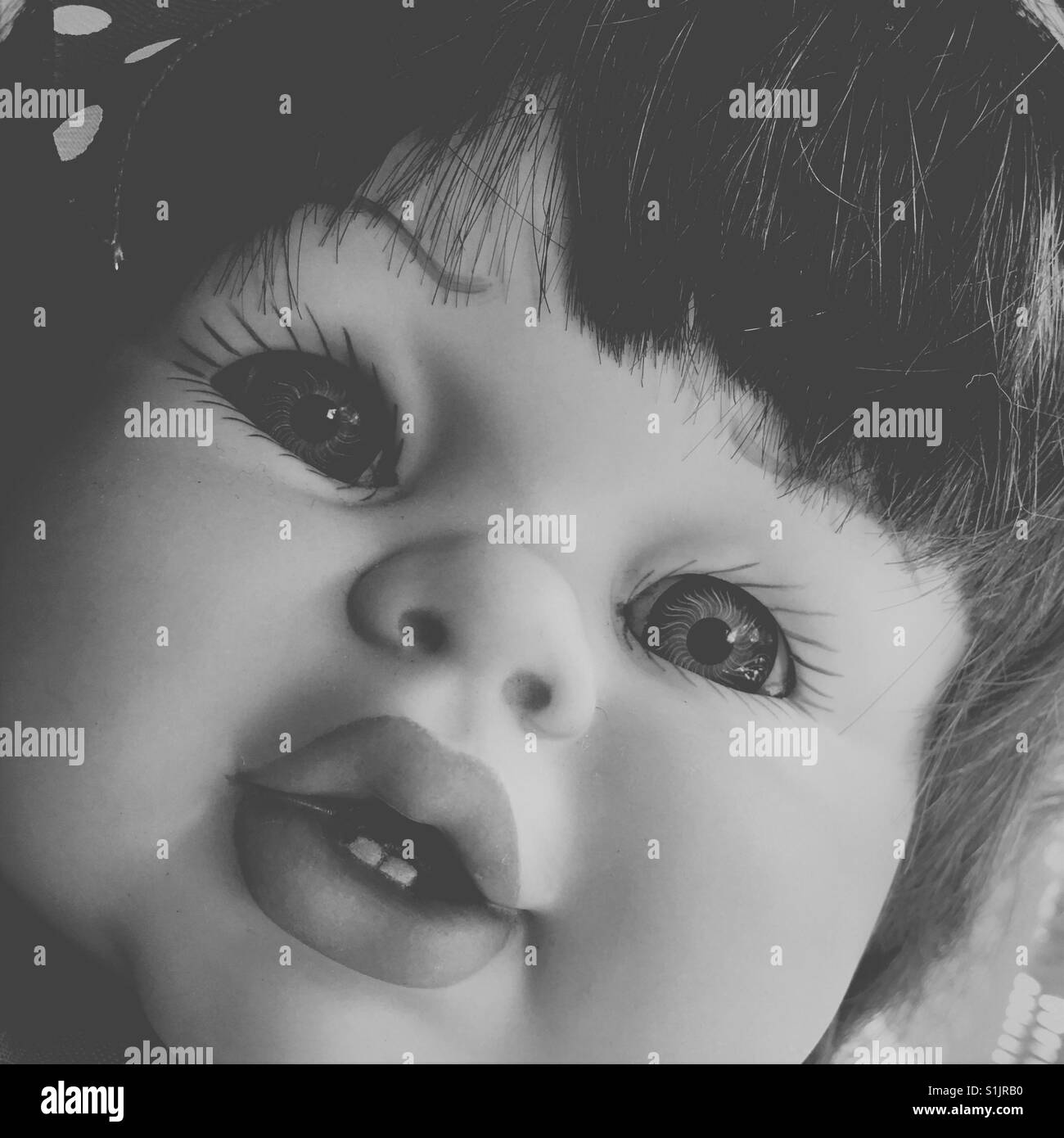 Doll face on black and white - Stock Image