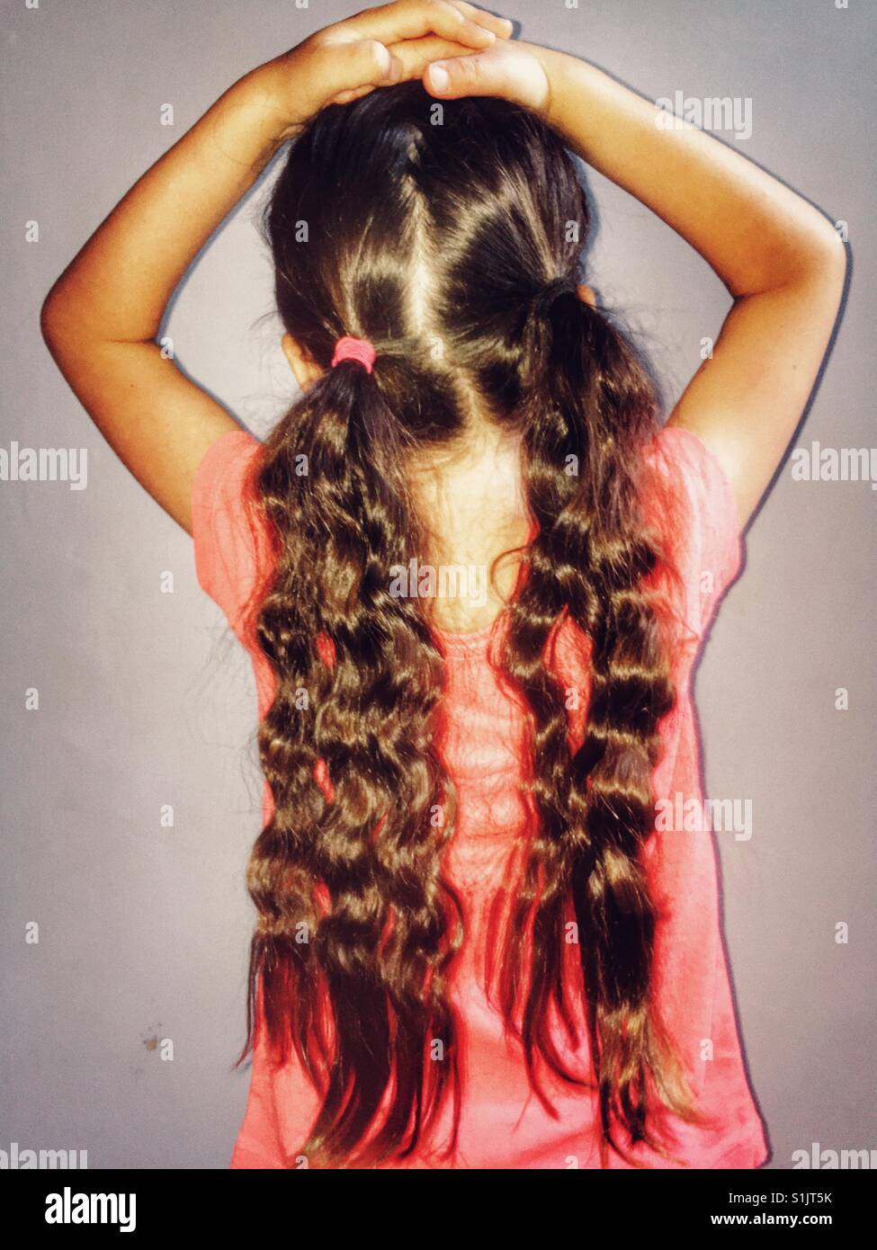Long ponytails - Stock Image