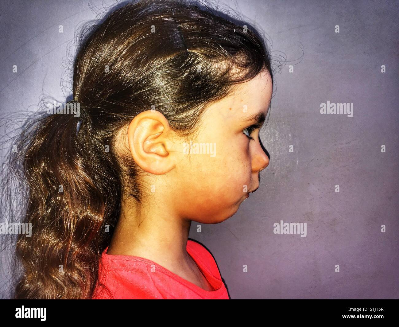 Girl wearing her hair in ponytails - Stock Image