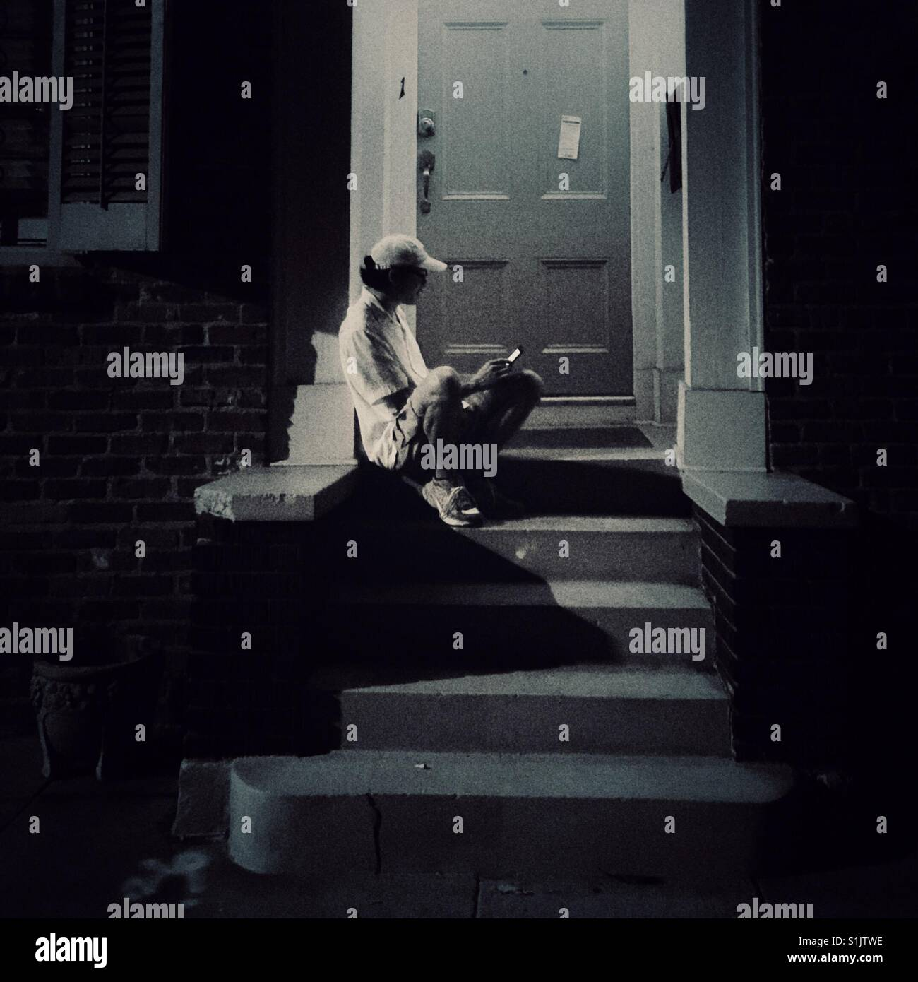 I forgot my key and have to sit on a porch outside in New Orleans - Stock Image