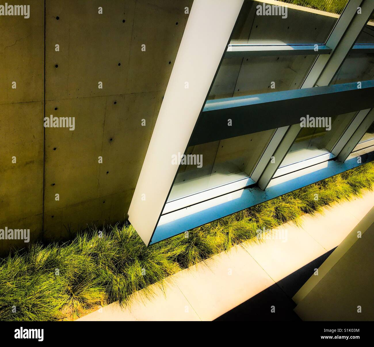 Surreal modern architecture glass building window looking suspended - Stock Image