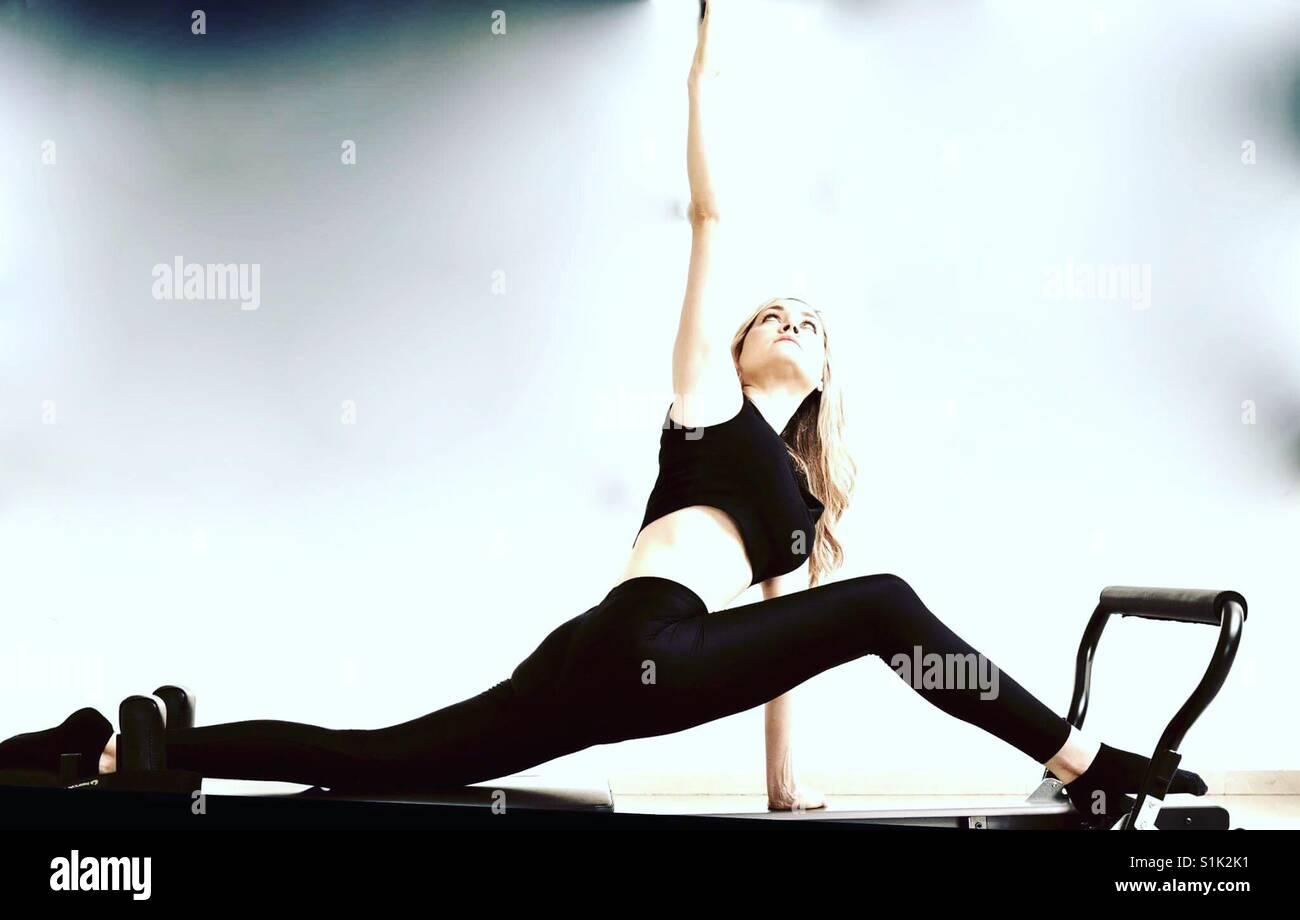 Pilates reformer fitness girl - Stock Image