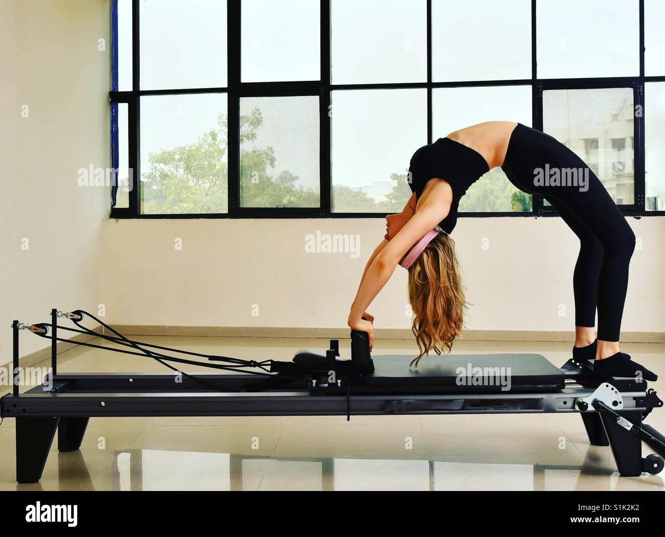 Pilates reformer flexibility bridge - Stock Image