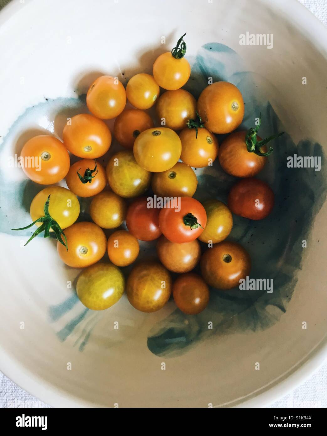 Cherry tomatoes plucked from a garden. - Stock Image