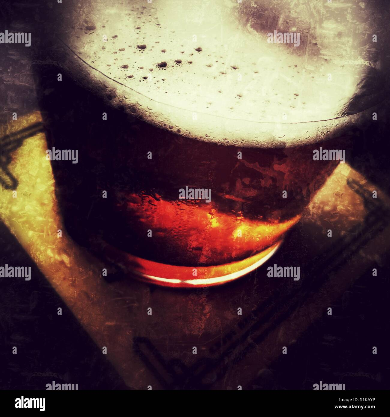 Pint of beer in a pub - Stock Image