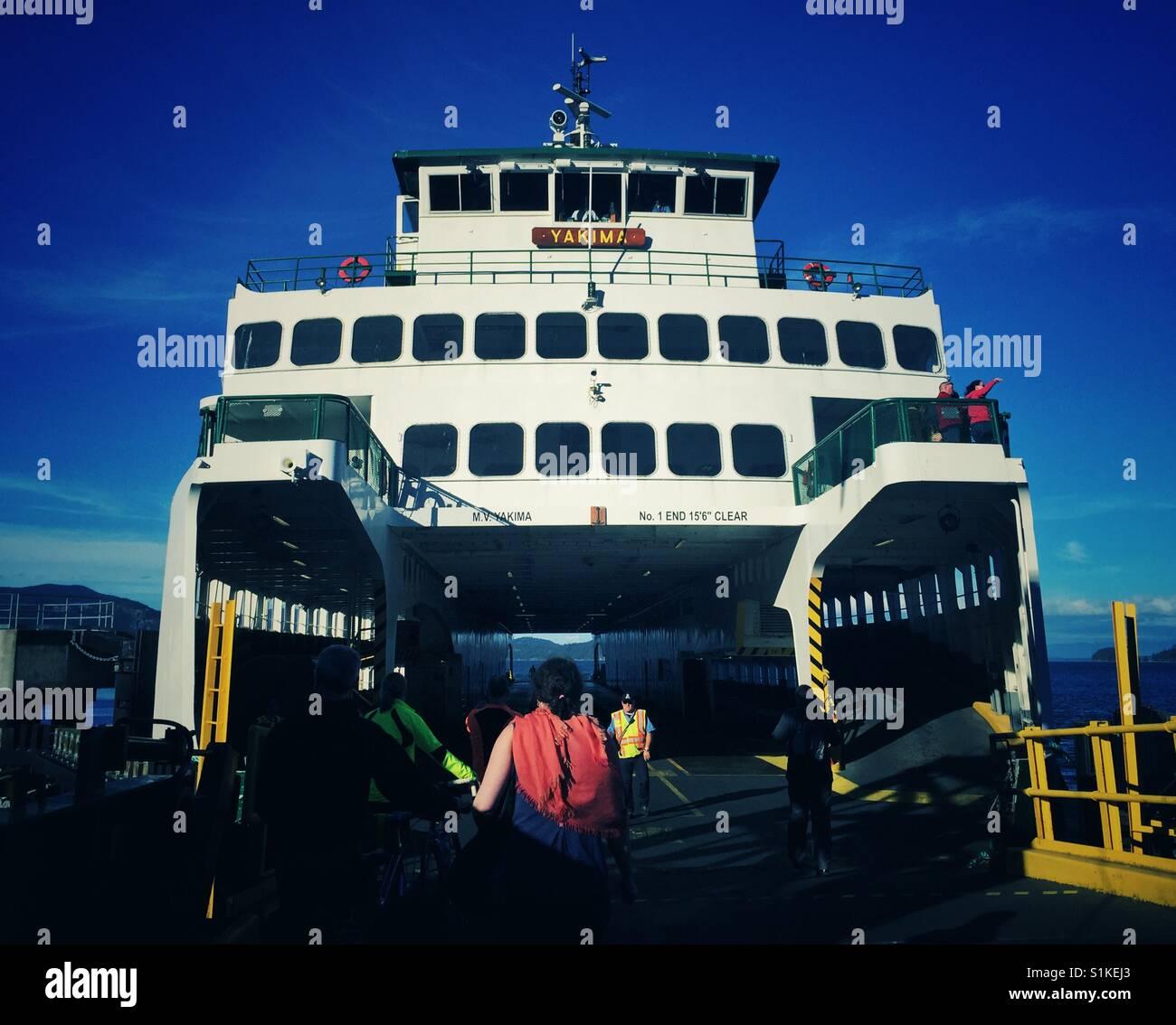 People walking on the Washington state ferry  on Lopez island - Stock Image