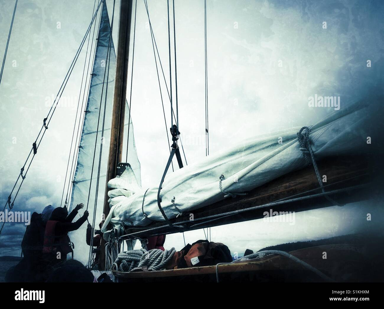 hoisting the mainsail - Stock Image