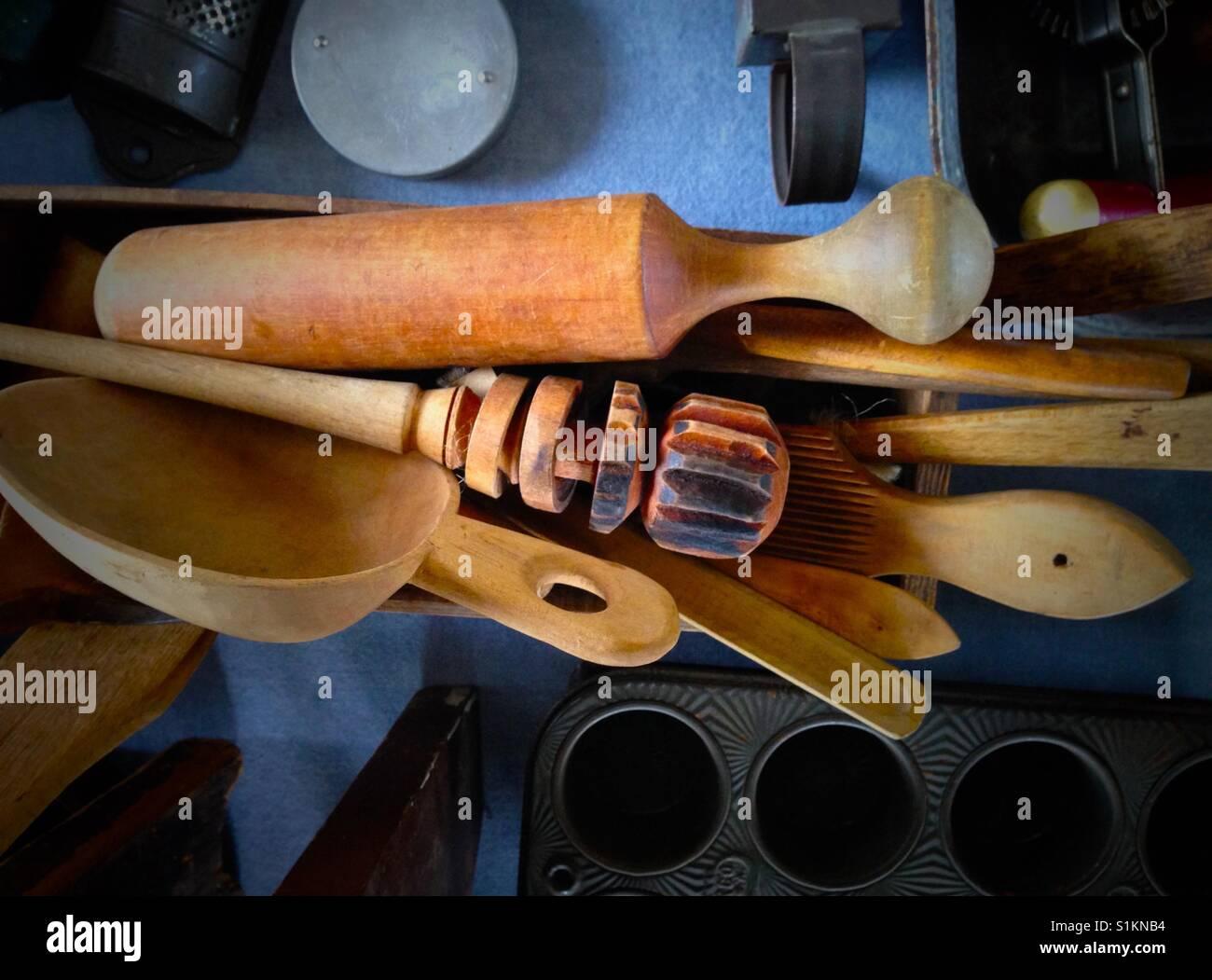 Antique wooden kitchen utensils. - Stock Image