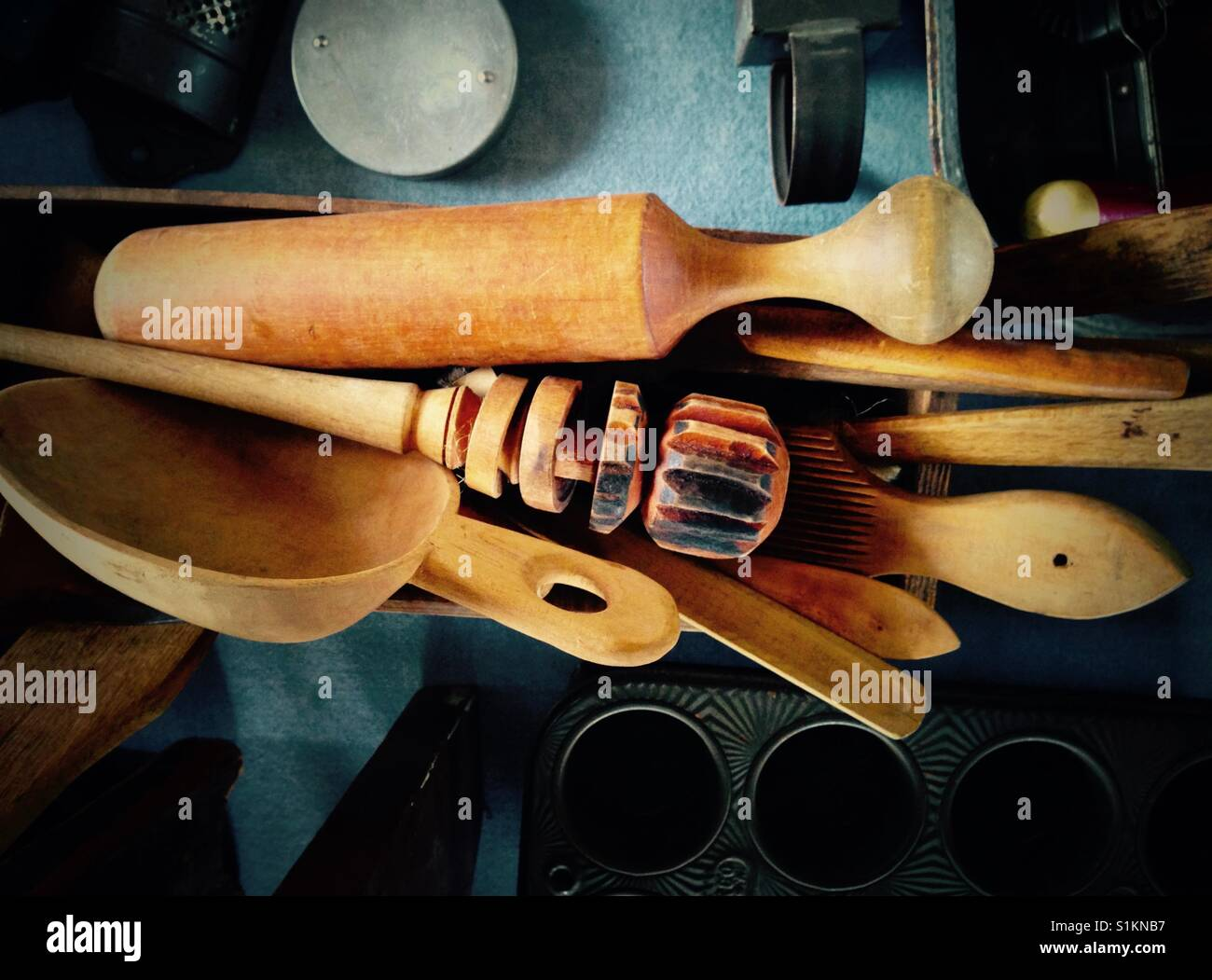 Antique wooden kitchen utensils and spoons. - Stock Image