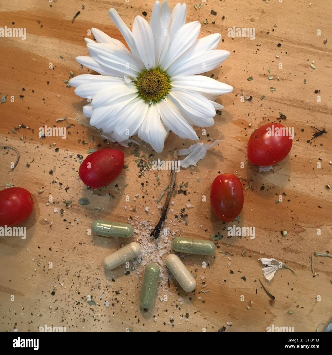 Artistic Herbal supplement capsules-- supplements breaking out of the pill box - Stock Image