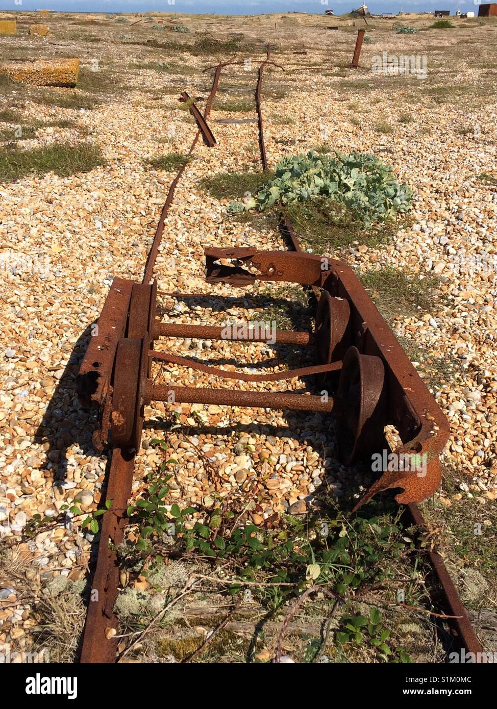Remains of narrow guage rail track across Dungeness beach - Stock Image