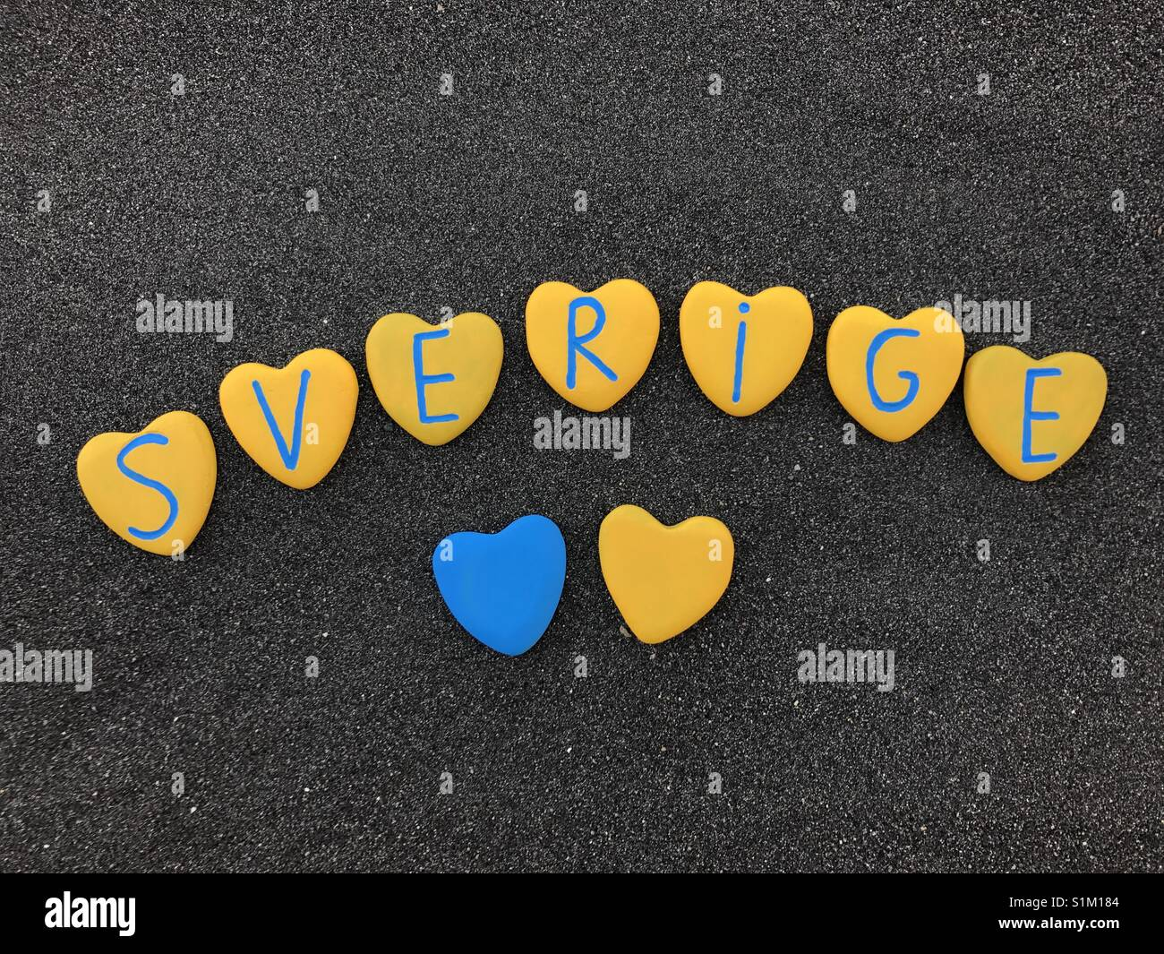 Sverige, Sweden, country name with national colors and heart stones letters - Stock Image