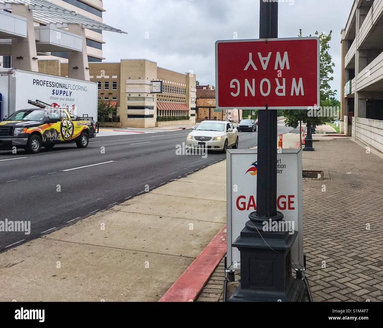 Upside down wrong way sign. - Stock Image