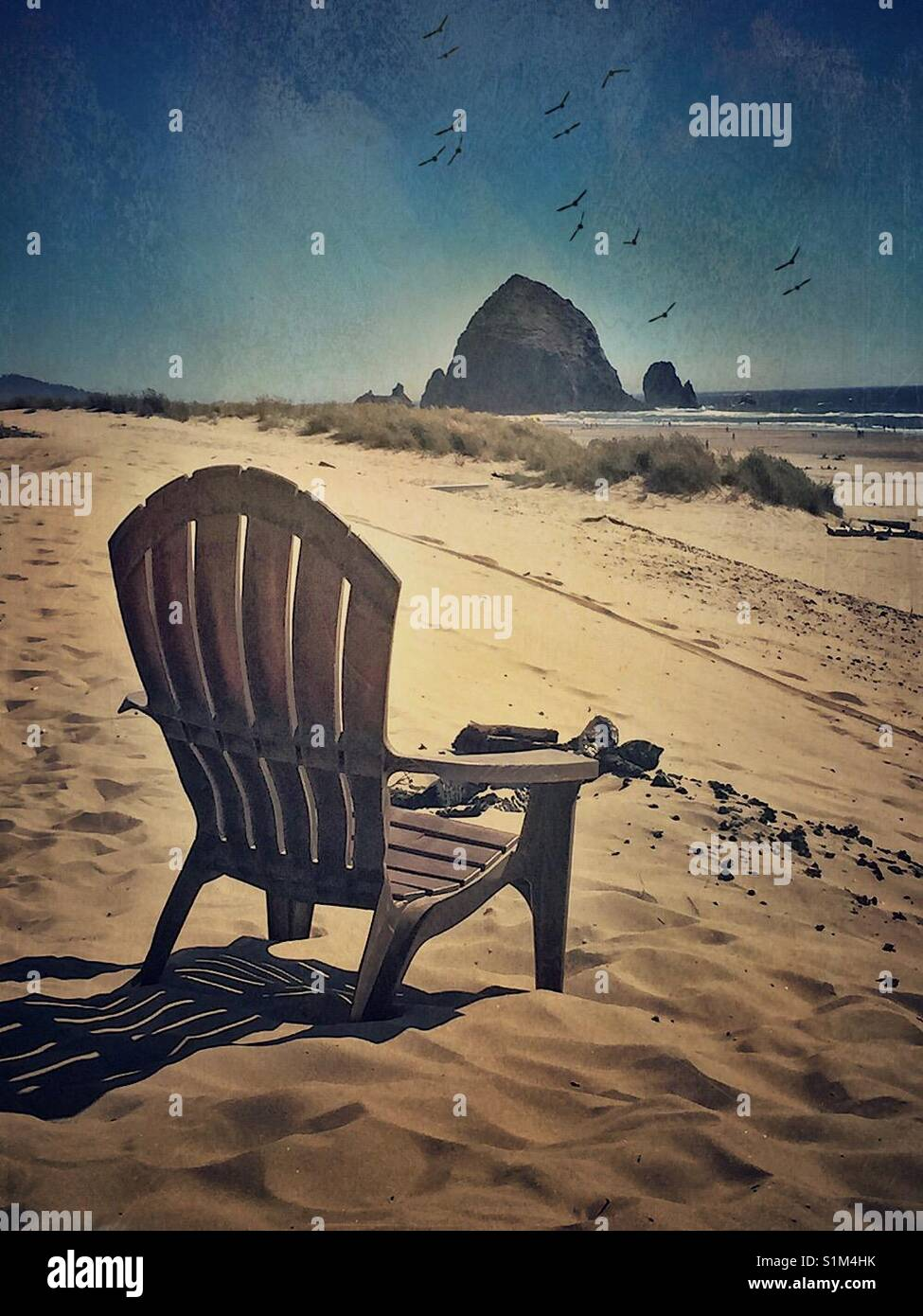 Beach Chair by Haystack Rock - Stock Image