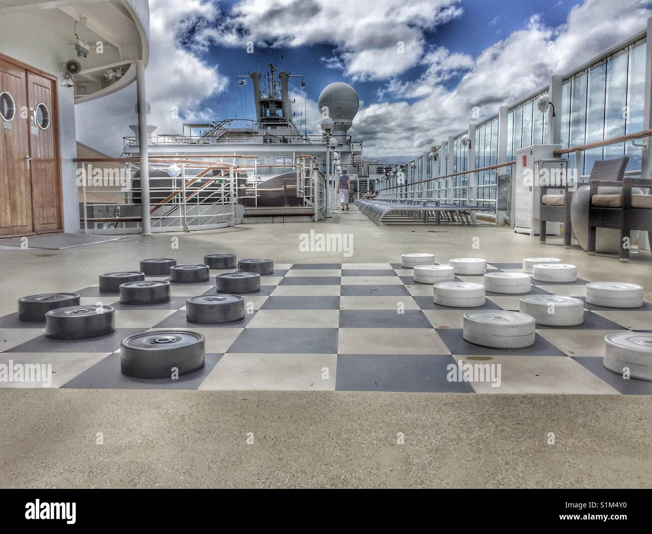 Giant checkers / draughts board game on outdoor deck of cruise ship. Outside active onboard cruise ship - Stock Image