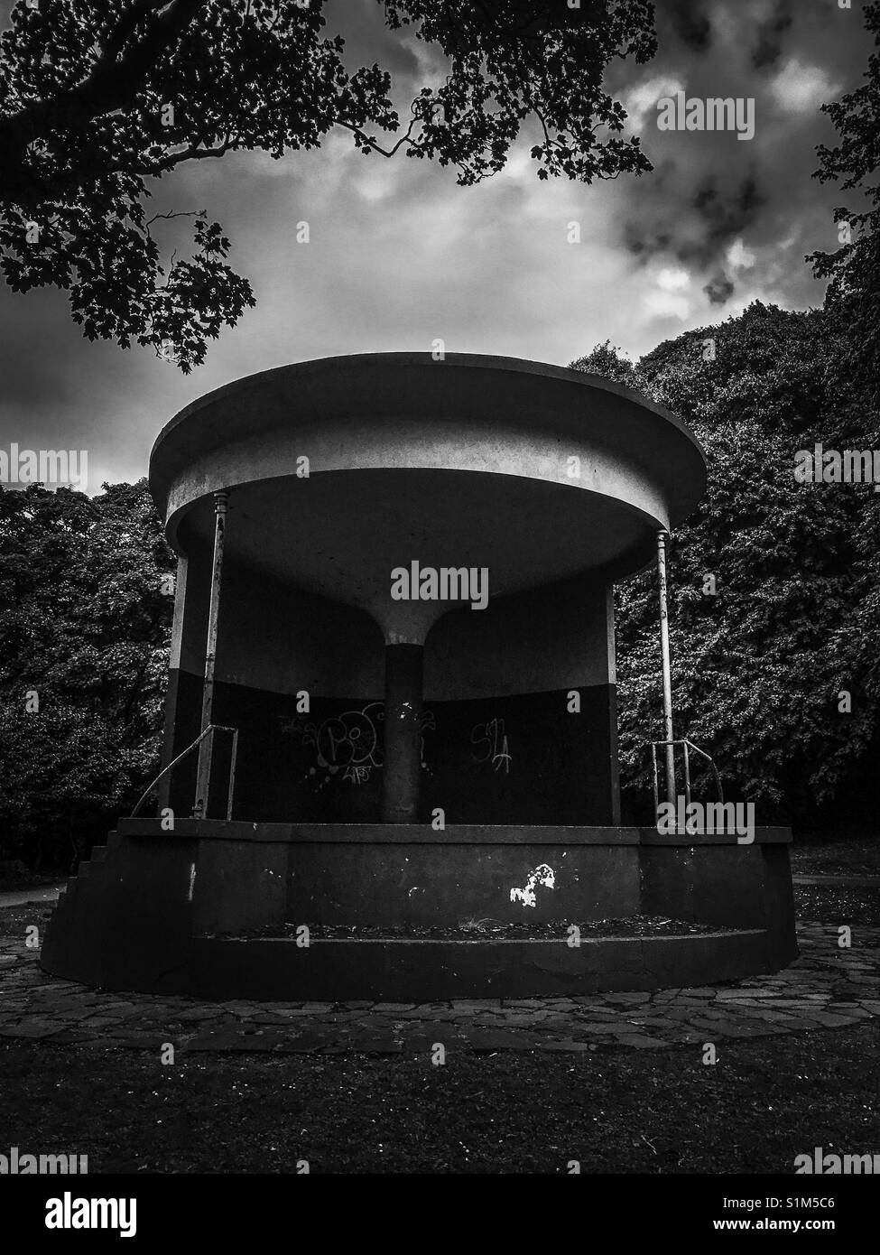Moody black and white image of bandstand in castle park Whitehaven Cumbria - Stock Image
