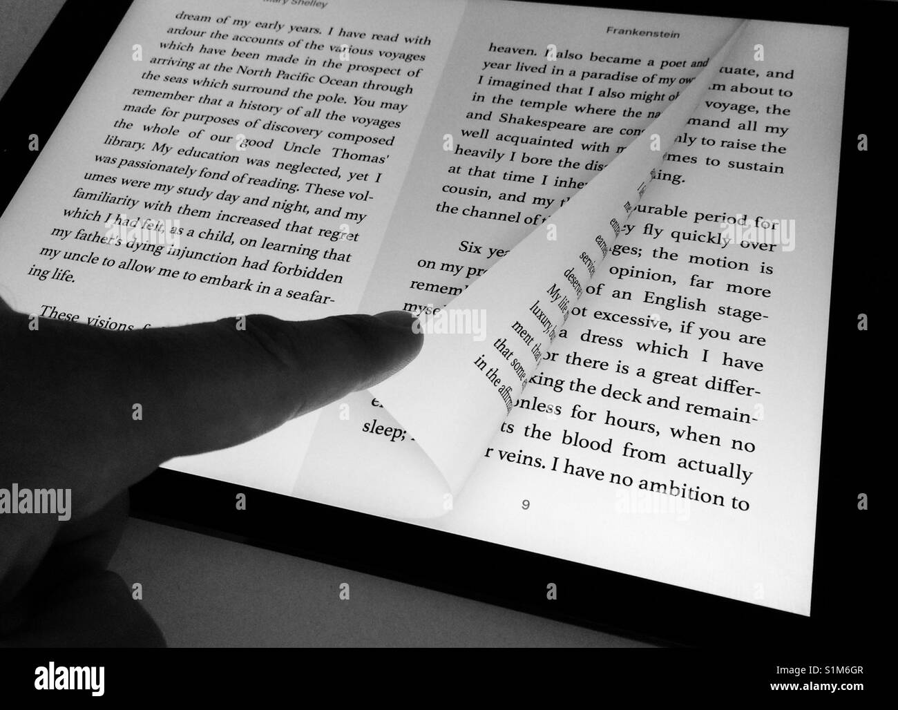Turning a page in an ebook on iPad - Stock Image
