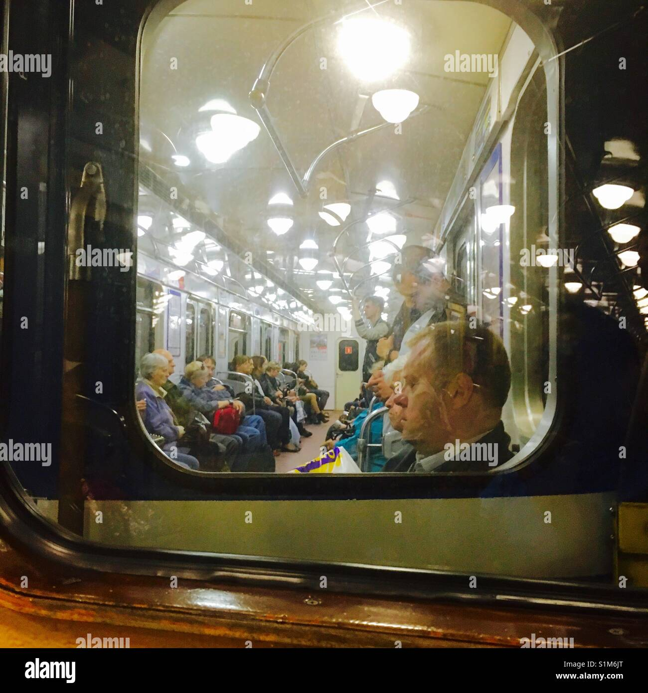 View into subway car of St Petersburg Russia subway - Stock Image