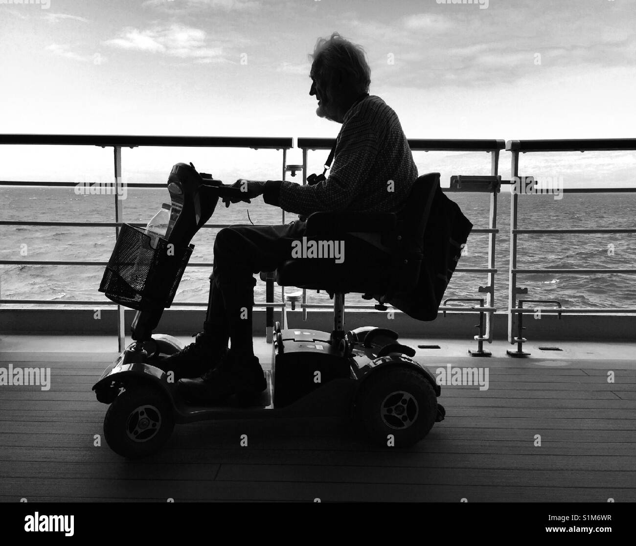 Disabled man on scooter on cruise ship - Stock Image