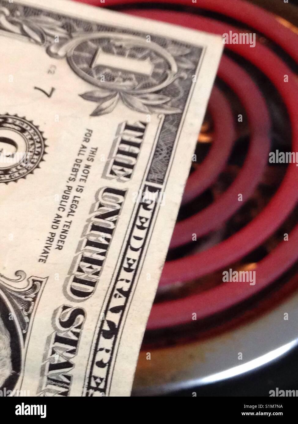 Burning money concept - Stock Image