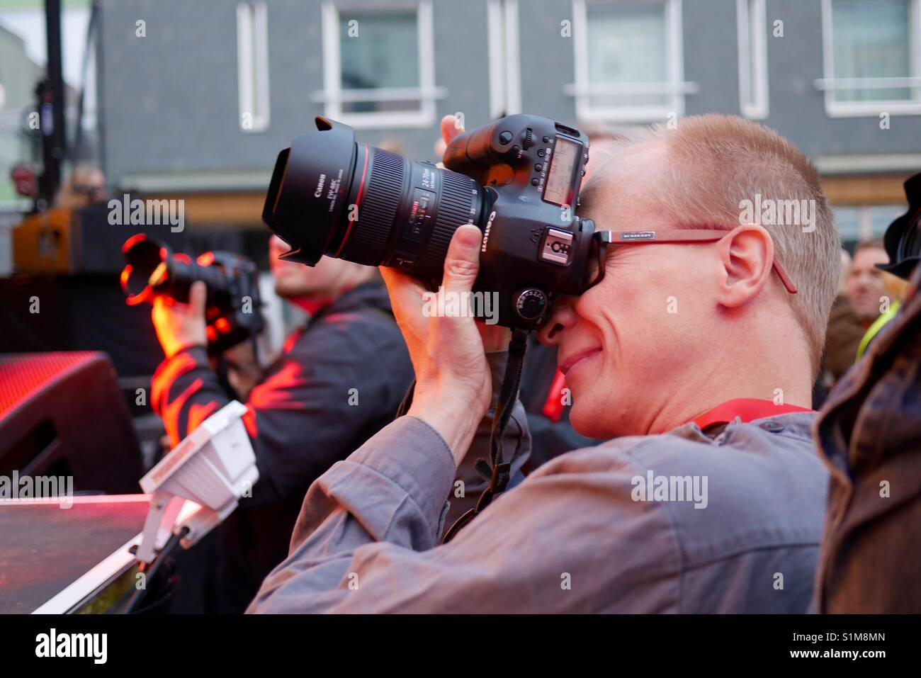 Photographer aiming Camera at  stage of Air Guitar World Championships in Oulu Finland - Stock Image