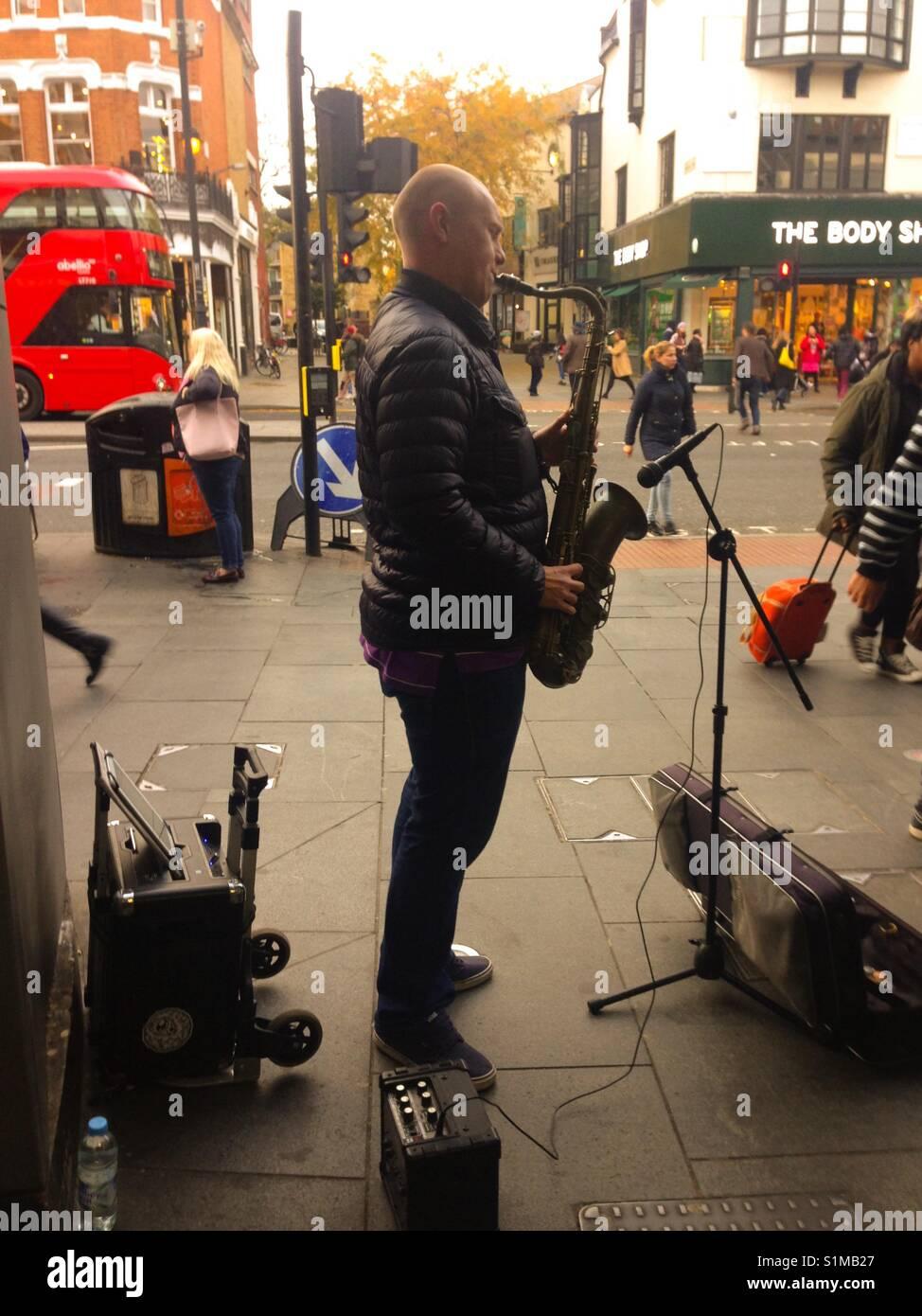 Basking at the underground station - Stock Image