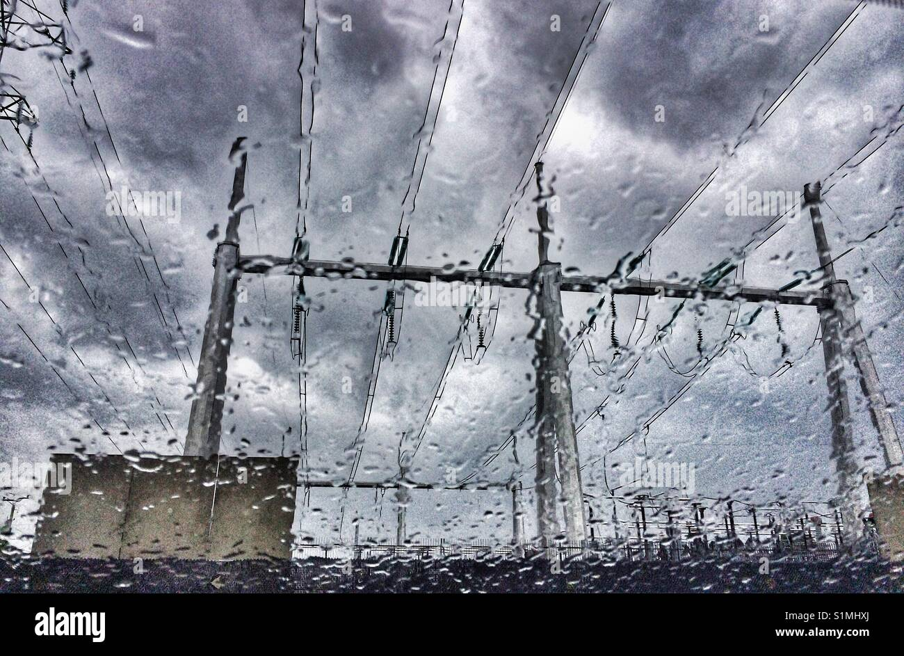 Electrical wires seen through a car windshield during stormy weather ...