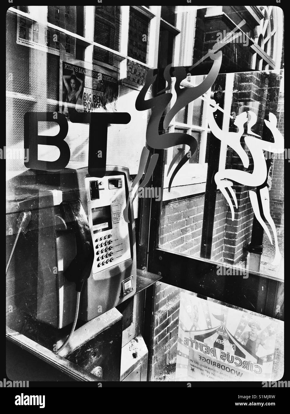 1990's BT Telephone Kiosk with the defunct 'The Herald' logo. - Stock Image