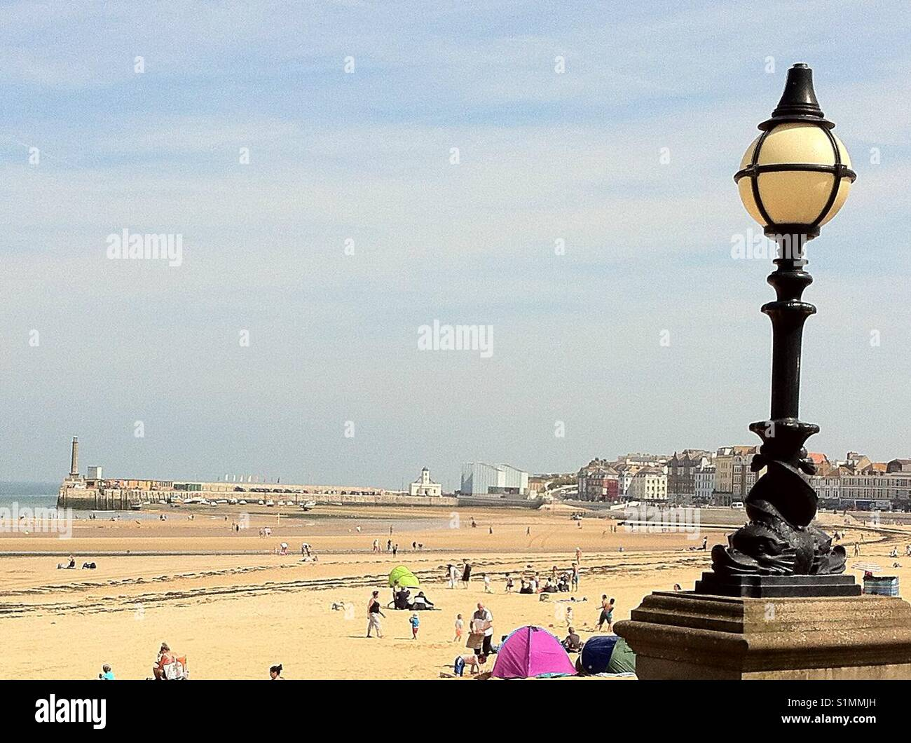Families enjoying the beach in summer holidays, Margate beach, Kent, uk. - Stock Image