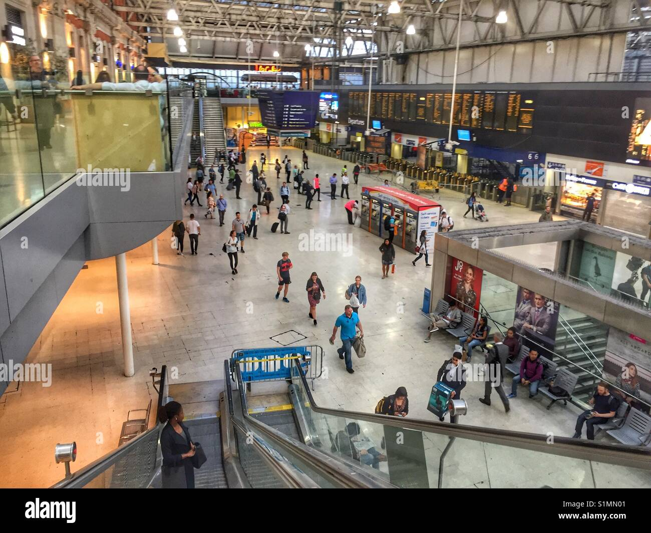 Commuters are seen at Waterloo Station as refurbishment works at the station continue and causes disruption to services, - Stock Image