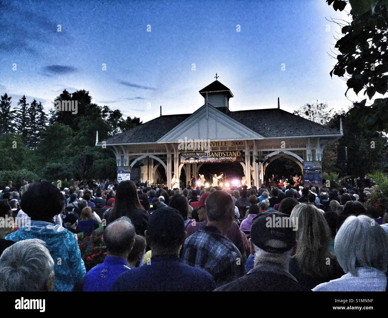 Outdoor music concert at the bandstand in Unionville, Ontario. - Stock Image