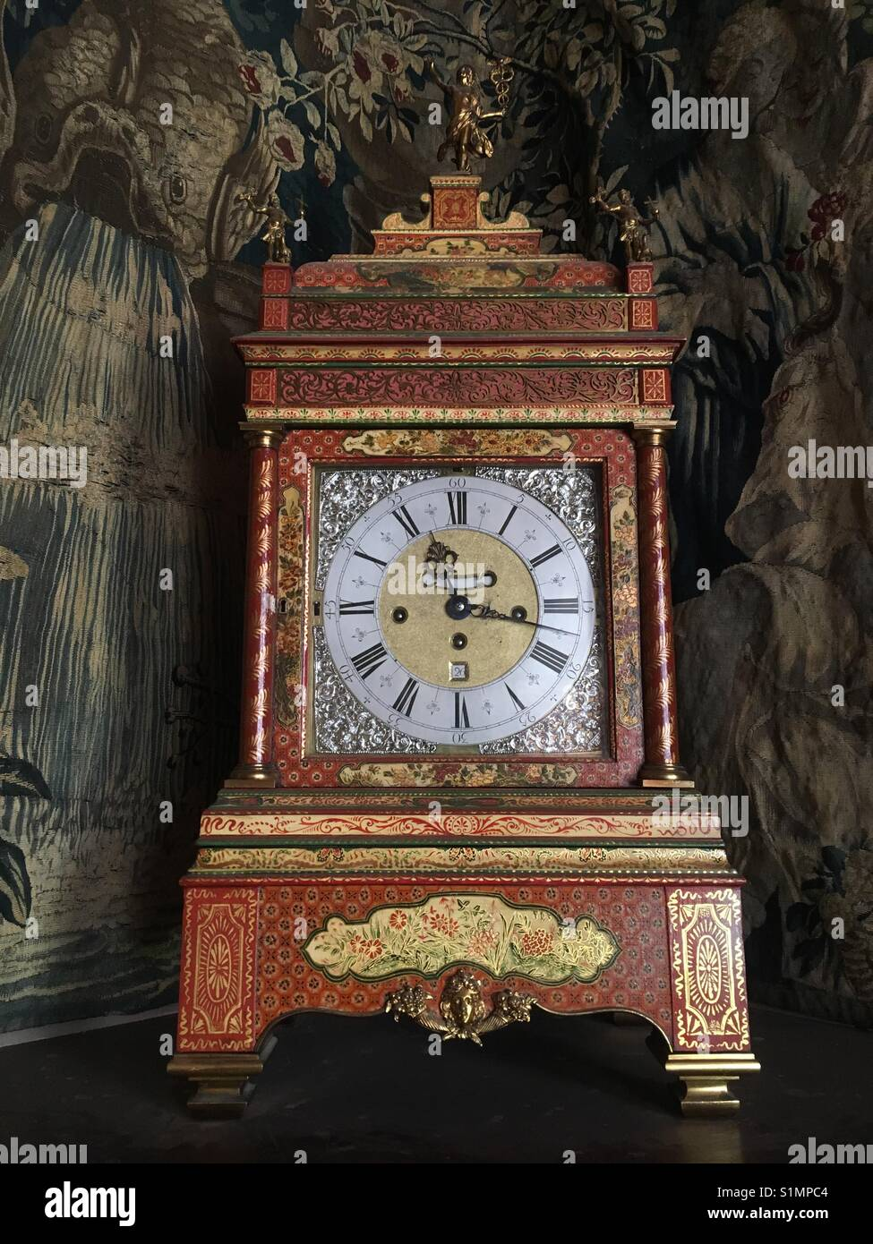 Antique clock at Lyme Hall, Lyme Park, Disley, Cheshire UK - Stock Image