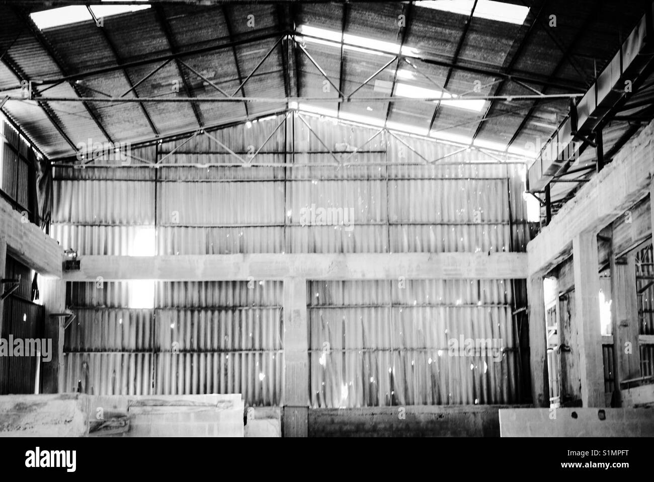 A warehouse riddled with bullet holes in Aida refugee camp in Bethlehem following the second intifada of 2002. - Stock Image