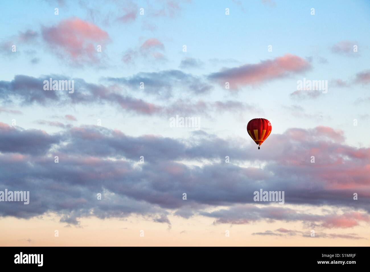 A baloon on a sunset sky - Stock Image