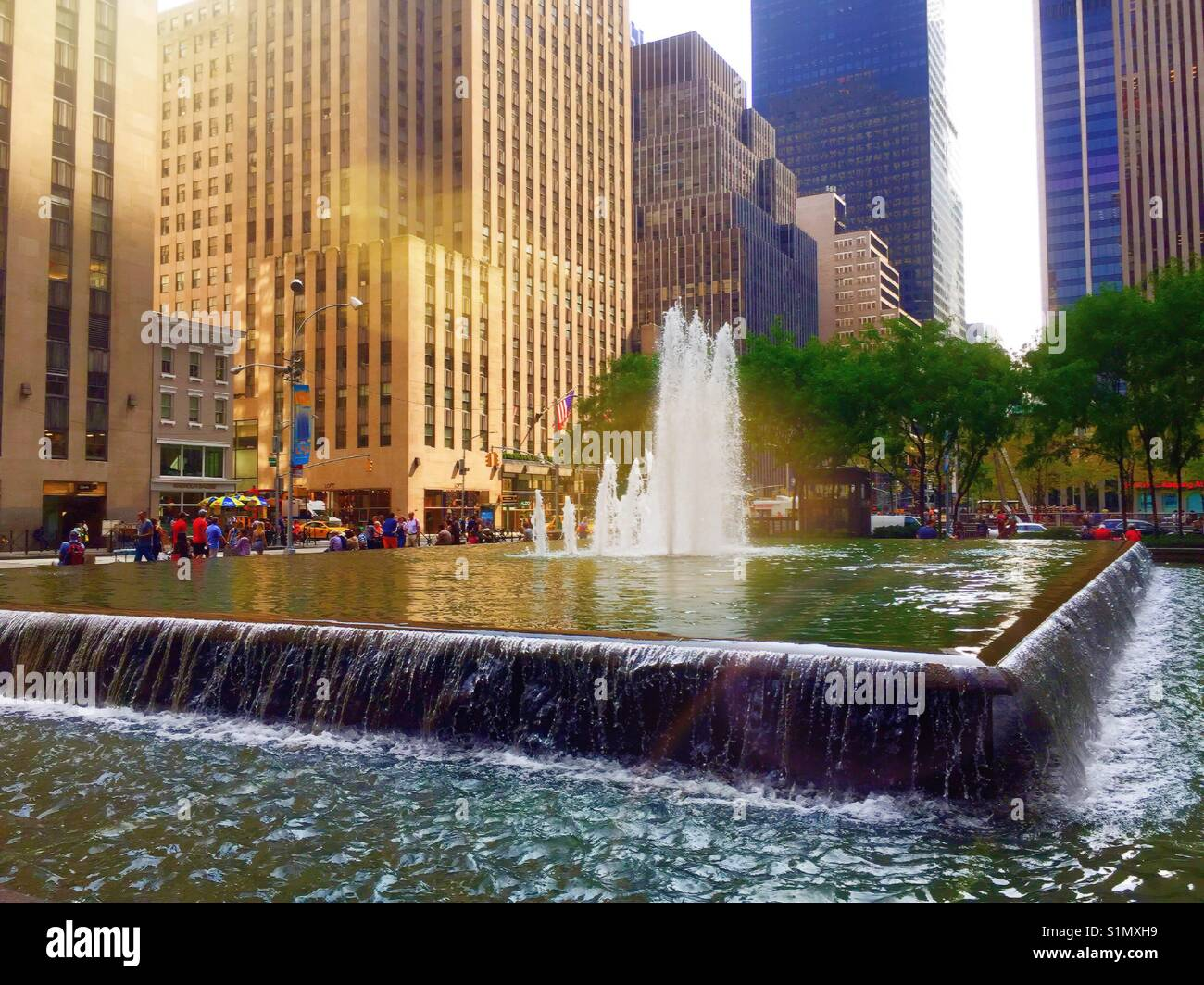 Reflecting pool and fountain, Rockefeller Center, Avenue of the Americas, NYC, USA Stock Photo